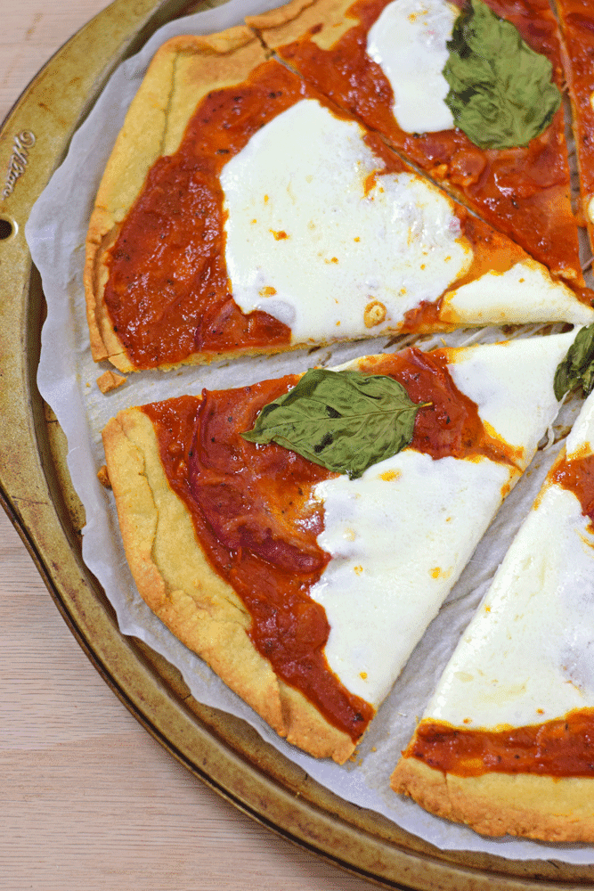 "Gluten Free Pizza Crust - Made with almond and potato flour, this Gluten Free Pizza Crust is one of my favorites. It's a nice thin crust that isn't overly ""rice-y"" like many gluten free mixes. // isabeleats.com"