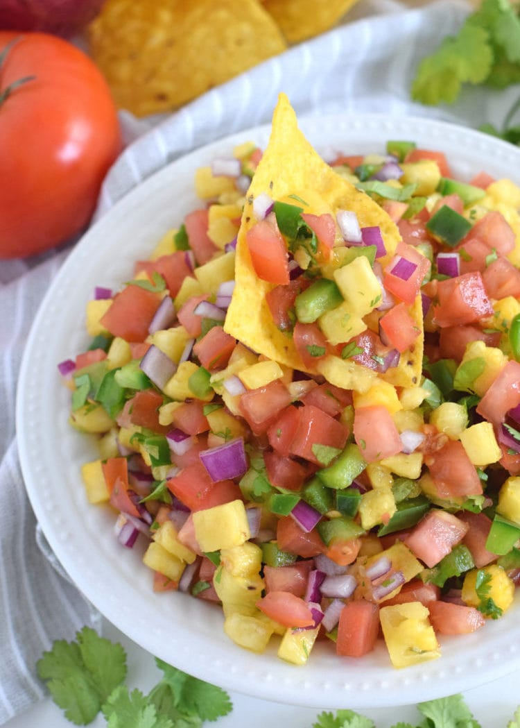 This Fresh and Easy Pineapple Salsa recipe only requires 6 ingredients and 15 minutes to make. It's the perfect appetizer for your next party and would also go great on some super delish fish tacos for a little crunch. So good! // isabeleats.com