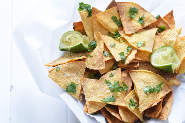 These Homemade Lime Tortilla Chips are crunchy, salty, easy to make and are baked with a hint of lime for a nice little zesty kick. They've taken my chips and salsa game to a whole new level! Perfect on their own as a snack or with some guac or salsa as an appetizer.