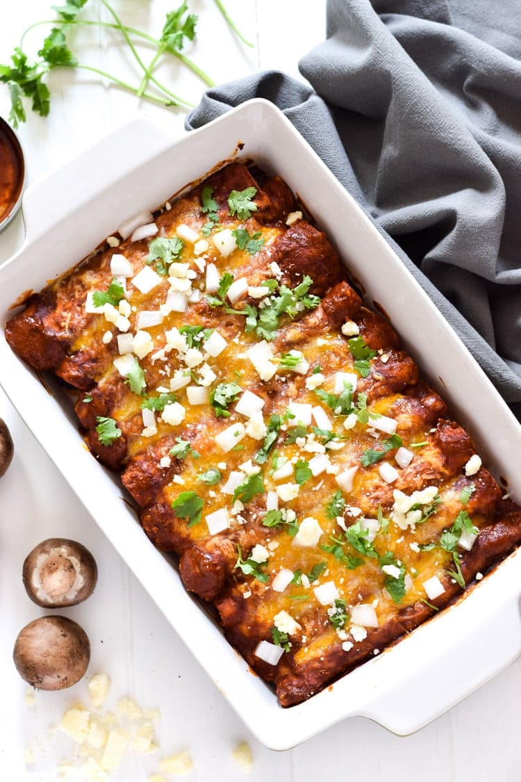 These Vegetarian Spinach Enchiladas are covered in a red enchilada sauce and stuffed with spinach, mushrooms and onions for a tasty Mexican dinner!
