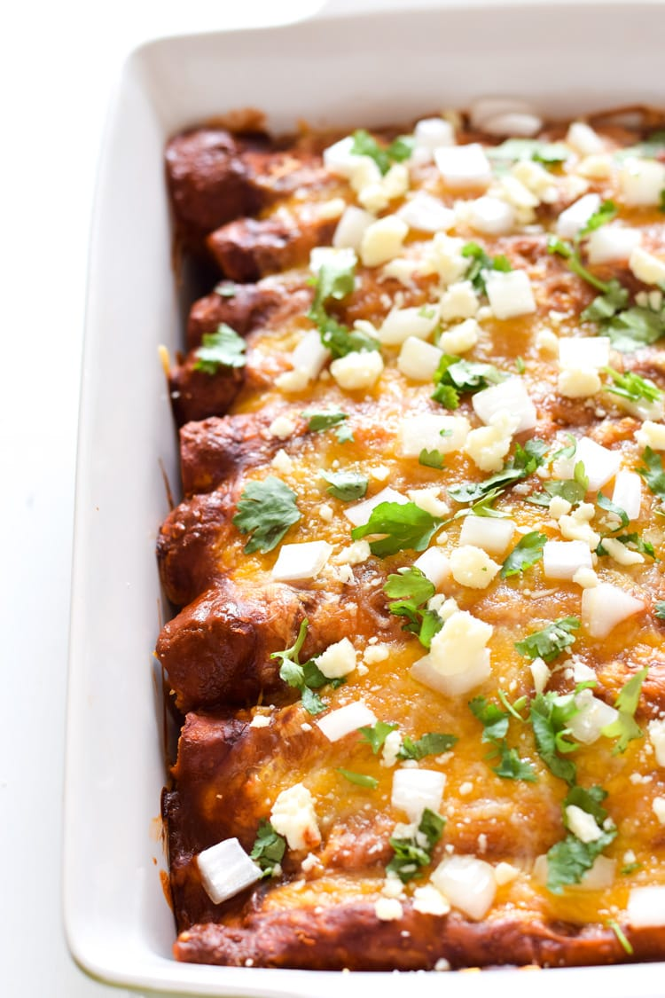 Covered in a Mexican Authentic Red Enchilada Sauce, these baked Spinach, Mushroom and Onion Red Enchiladas are great for dinner and make tasty leftovers that everyone will be excited to eat. They're vegetarian and also gluten free!